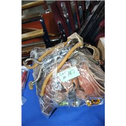 Bag with: 2 Combo Cable Locks; Slings; Belts & Sling Shot