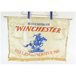 Winchester Banner and Tin Hunter Parking Sign