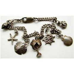 STERLING CHARM BRACELET WITH NAUTICAL CHARMS