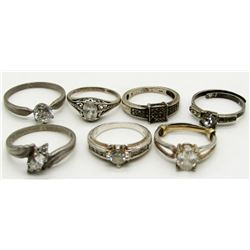 7 STERLING SILVER RINGS - CLEAR STONES