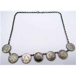 STERLING NECKLACE WITH (7)FOREIGN COIN CHARMS