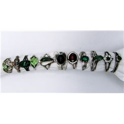 11-STERLING RINGS WITH GREEN CENTER STONES