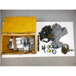ASSORTED CLEANING ACCESSORIES AND GUN PARTS IN A WOODEN CRATE