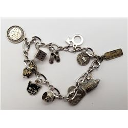 STERLING CHARM BRACELET WITH (11)925 CHARMS