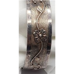 ANTIQUE STERLING CUFF WITH FLORAL DESIGN