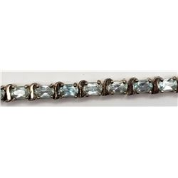 7 INCH STERLING BRACELET WITH LIGHT BLUE STONE