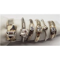 6-STERLING RINGS WITH CLEAR CENTER STONES
