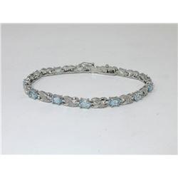 Blue Topaz & Diamond Infinity Design Bracelet