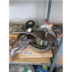 assorted pots and pans and cutting board