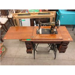 Singer Sewing Machine in Oak Treadle Stand