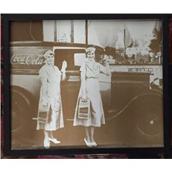 Blown Up Photo of Coca Cola Workers Standing in Front of a Coca Cola Truck in Uniform
