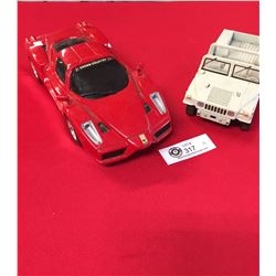 2 Plastic and Die Cast Cars. Ferrari and Hummer