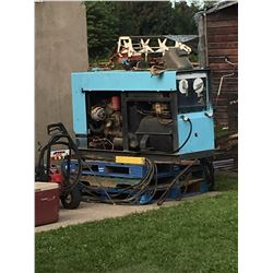 Miller 40 Ark Welder, on metal skid, gas