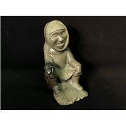 "INUIT HAND CARVED SOAP STONE SCULPTURE OF A MAN SITTING, 10"" TALL"