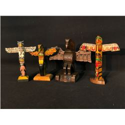 "COLLECTION OF 4 HAND CARVED NATIVE COMMERCE POLES, 7""-9"" TALL"