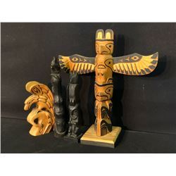 "COLLECTION OF 4 HAND CARVED NATIVE COMMERCE POLES, 6.5""-12.5"" TALL"