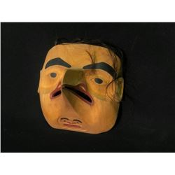 "WAYNE CARLICK HAND CARVED AND PAINTED ""RAVEN CHILD"" MASK WITH HORSE HAIR ACCENTS,"