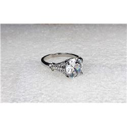 14)  WHITE TOPAZ SOLITAIRE RING WITH