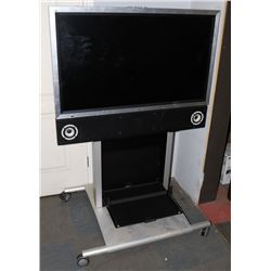 TOMBERG TV IN BUILT IN STAND.