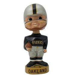 Vintage 1960's Oakland Raiders Gold Base Bobblehead