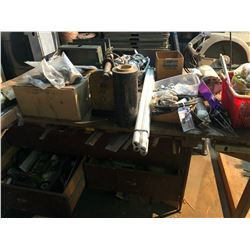 WORK BENCH WITH ASSORTED CONTENTS INCLUDING RATCHET STRAPS, SHACKLES, CASTERS, DRILL VICES AND MORE