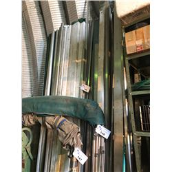 LARGE ASSORTMENT OF ALUMINUM PIPE, FLAT BAR AND MORE ON WALL
