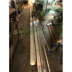 LOT OF ASSORTED ALUMINUM FLAT BAR, CHANNEL AND MORE ON GROUND