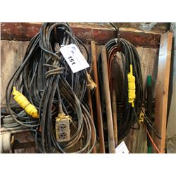 LOT OF ASSORTED EXTENSION CABLE/LIGHTING ON WALL