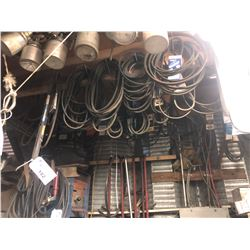 LARGE QUANTITY OF ASSORTED BELTS ON WALL/CEILING