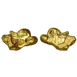 """Small gold """"oro corriente"""" piece of a small nugget with partial cross stamp applied, 9.19 grams."""