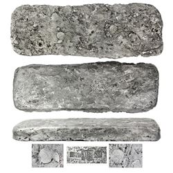 """Silver """"tumbaga"""" bar #M-66 (""""key bar""""), 21.66 lb av, showing un-melted disks on top, marked on botto"""