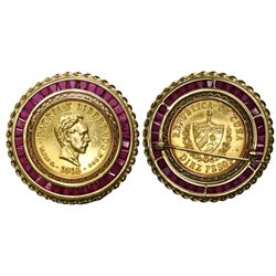 Cuba, gold 10 pesos, 1915, mounted in 18K gold pin with rubies around perimeter.