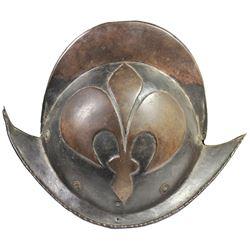 1600s German morion helmet with embossed fleur-de-lis pattern.