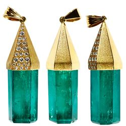 Massive natural crystal emerald mounted in 18K pendant with 22 diamonds, 22.65 grams total weight.