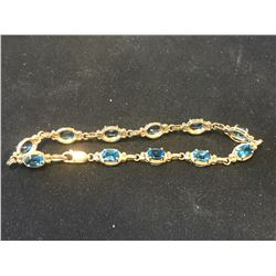 STAMPED 10K GOLD BLUE STONE BRACELET  (AUTHENTICITY UNKNOWN - RCMP RECOVERED)