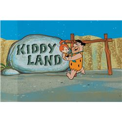 'Fred Flintstone' and 'Pebbles' production cel on a pan production background from The Flintstones.