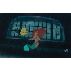 'Ariel' and 'Flounder' production cels on a matching print background from The Little Mermaid.