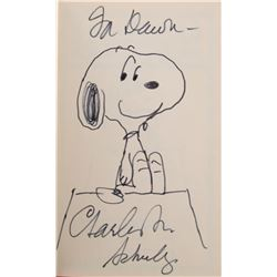 Charles Schulz drawing of 'Snoopy' on his doghouse.
