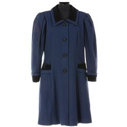 Early Disneyland female castmember's long navy blue winter topcoat from Fantasyland.