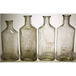 Four N. E . Wilson Co. Bottles  57729