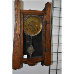 Antique mission style wall mount chiming clock with decorative visual pendulum, working at time of c