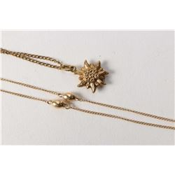 "14kt yellow gold 15"" necklace with bead decoration and a 9ct flower pendant on a 12 kt gold plated c"