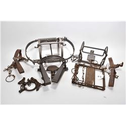 Six vintage small animal traps including three leg hold