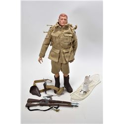 Vintage G.I. Joe action figure patented 1964 with accessories including snow shoes and boots, two ri