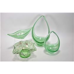 Four pieces of art glass including two graduated pieces, boat shaped dish and a ruffled dish, all be