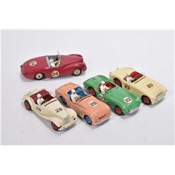 Five vintage Dinky Toy racecars including Sunbeam Alpine # 107, MG Midget #108, Austin Healey #109,
