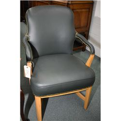 Pair of heavy quality blonde oak framed open arm parlour chairs, re-upholstered in green leather wit