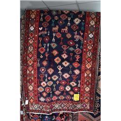 100% wool Iranian Sarab area carpet with overall geometric design with stylized animals, vessels, bi