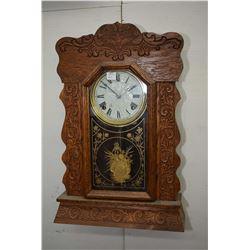 Antique Arthur Pequegnat chiming gingerbread clock with decorative gilt pendulum