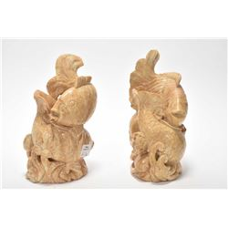 """A pair of stone carved koi motif candleholders 7"""" in height"""